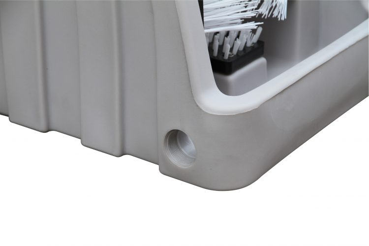 The image shows a hole in the side of the boot cleaner which a wastewater pipe is connected to